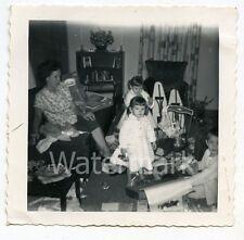 1950s vintage b/w snapshot  photo Kids open Christmas Gifts Toys