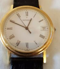 MENS  MOVADO 14 k  Solid GOLD, Swiss, Sappire Crystal, Date Watch