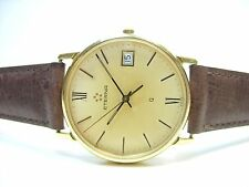 ETERNA MONTRE HOMME PLAQUE OR QUARTZ