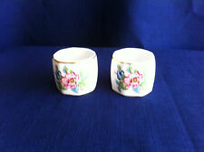 2 Aynsley Pembroke napkin rings ( some rim gilt wear on one)