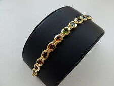 Bracelet with Tourmaline+Fire opal+Peridot+Tanzanite+Brilliant in 750