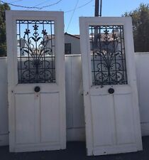 Two French Solid Oak Entry Doors with Art Nouveau Iron Grills, circa 1900