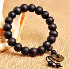 1 *  Bracelet 12mm Perles en bois noir bouddhiste avec Pièces en cuivre
