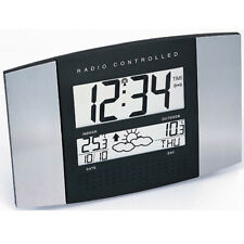 RADIO-CONTROLLED WALL CLOCK RADIO CONTROLLED WS 8117 WEATHER STATION DATE
