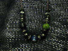 Gun metal necklace strung with metal and plastic/glass beads.  Very pretty!