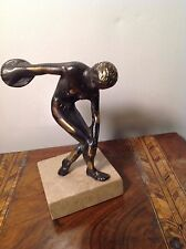 Statue depicting Ancient Olympian Discus thrower Bronze or Brass on Marble