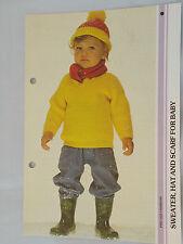Tejer patrón suéter, sombrero y bufanda para bebé