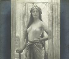 RPPC: Bare-breasted YOUNG WOMAN SCULPTRESS by German painter MAX NONNENBRUCH