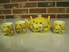 FLORAL DESIGN YELLOW TEAPOT AND THREE CUPS