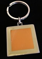VEUVE CLICQUOT CHAMPAGNE KEYRING WITH ORANGE ENAMEL SQUARE.