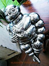 LARGE DECORATIVE SILVER FINISH MICHELIN MAN FIGURE.