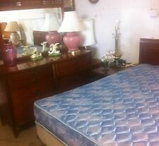 Antique queen bedroom set with a veneer finish.