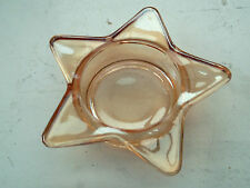 SMALL PALE AMBER GLASS TEA LIGHT HOLDER IN A STAR SHAPE