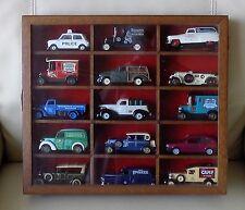 12 coches modelo (la mayoría de Lledo)