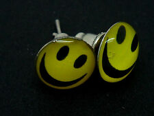 A PAIR OF YELLOW SMILEY FACE  THEMED STUD EARRINGS. NEW.