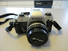 Nikon FG SLR with multiple lens, filters, adapters, cases, bag, etc