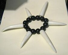 Great fun fancy dress black and white elasticated bracelet with beads & teeth