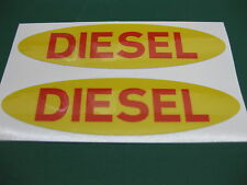 2 OVAL DIESEL FUEL STICKERS IN YELLOW WITH RED TEXT