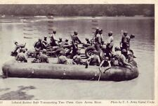 1944 INFLATED RUBBER RAFT TRANSPORTING TWO 37MM. GUNS ACROSS RIVER US Army photo