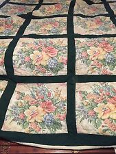 Queen size handcrafted green cotton quilt with floral design