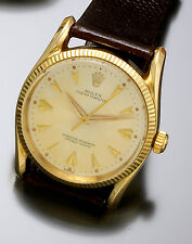 Rolex Watch | Oyster Perpetual 25-jewel Automatic 14K Gold Bombay Lugs