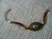 VINTAGE glass bead lucky eye  red black yellow blue