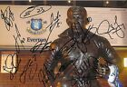A 12 x 8 inch photo personally signed by 15 Everton players & staff.