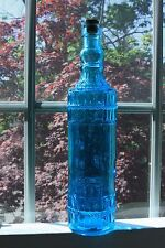 """Vintage embossed blue glass bottle with cock.12"""" high.."""