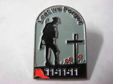 Soldier at grave lest we forget pin badge