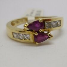 This beautiful 14ct yellow gold ruby and synthetic diamond ring