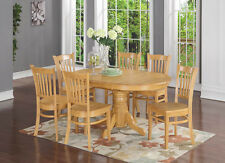 7 Piece formal dining room set- Oval dinette table with Leaf and 6 Dining Chairs