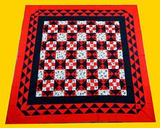 Sparkling Diamond style quilt top with a Super border.  Black, White & Red