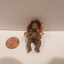 MINIATURE AFRICAN AMERICAN BABY DOLL MADE OUT OF CLAY