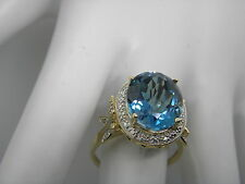 THL 10K YELLOW GOLD BLUE TOPAZ  AND DIAMOND RING,SIZE 8.