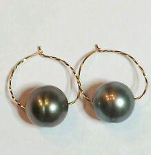 High luster grey black Tahitian pearl earrings baroque 14k gold huggie hoop