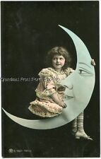 RPPC DARLING LITTLE GIRL sitting on PAPER MOON  ANTIQUE TINTED PHOTO POSTCARD