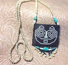 "She Who Watches (Tsagaglalal); 28"" Amulet Bag with Turquoise and Bone Beads"