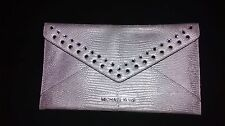 MK SILVER CLUTCH WITH RHIMESTONES