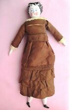 "GERMAN ANTIQUE 11 1/2"" CHINA DOLL WITH WRESTLER LEGS AND PATTERNED CLOTH BODY"