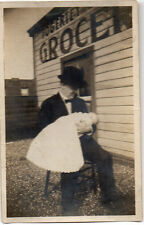 Man Holding Baby at the Fogerty Grocery Store Photo @1900