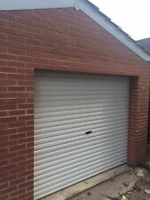 roller Garage door in white manual fully Installed Installation Fitting