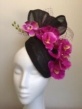 Black air hostess fascinator with purple orchids and netting. Gorgeous on!