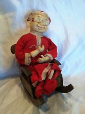 Old Vintage AntiqueOld Man Doll In Red Pajamas on wooden rocking chair