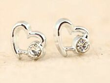 Tiny silver tone heart stud earrings with a crystal