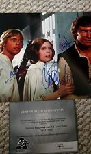 Carrie Fisher, Harrison Ford & Mark Hamill Hand Signed 8 x 10 Photo W/ COA