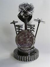 "Drummer ""Bash"" metal sculpture made from re-cycled piston, automotive components"