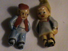 Antique small porcelain pin back dolls