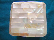 A  newly made natural mother of pearl jewellery box
