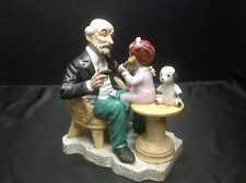 Porcelain Figurine Sitting Man with Little Girl on phone, with stuffed animal