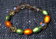 Very pretty elasticated beaded bracelet, Orange and Green beads